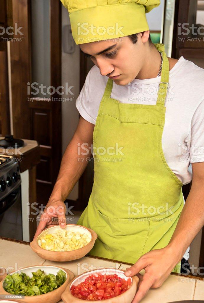 Chef in preparing sauces stock photo