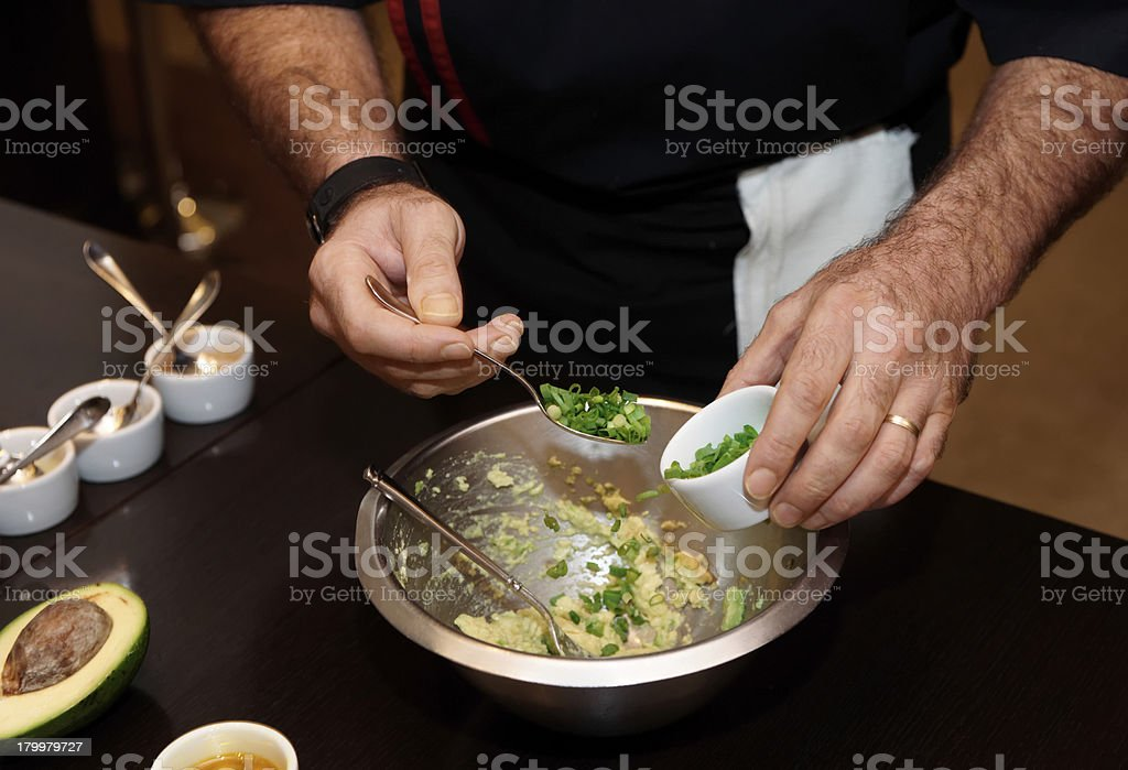Chef is adding green onion in sauce royalty-free stock photo