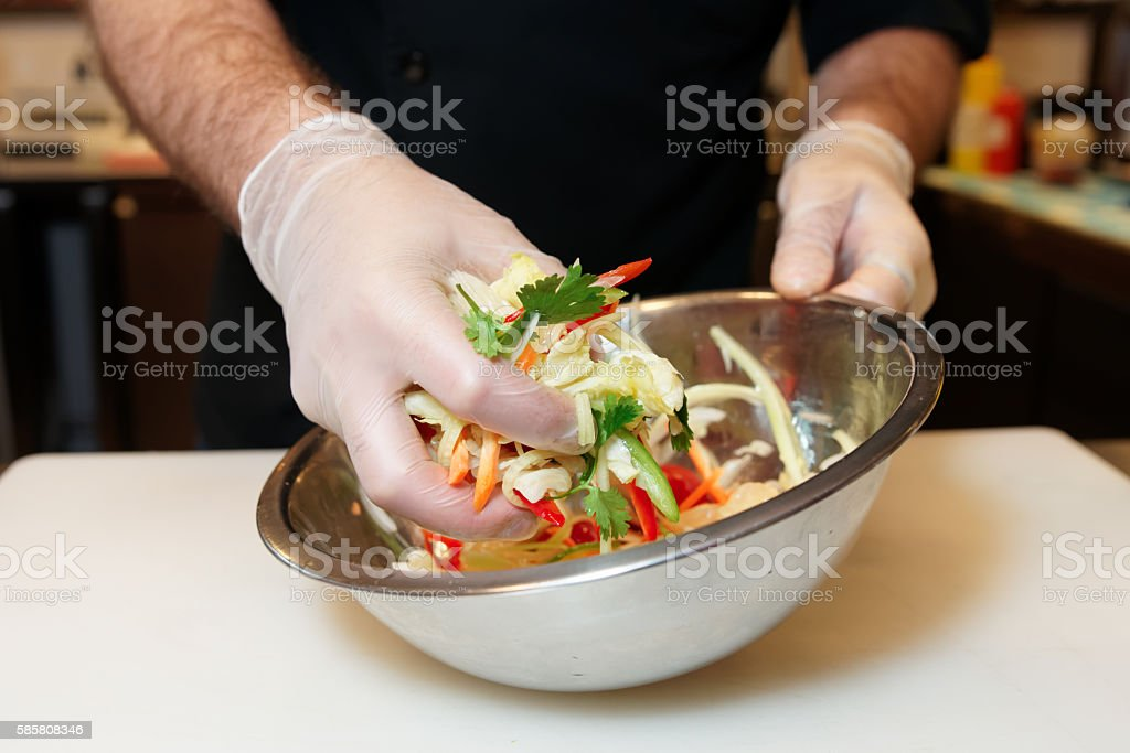 Chef is cooking a vegetarian salad stock photo