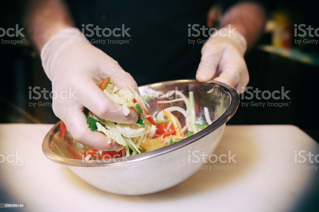 Chef is cooking a vegetarian salad, toned image stock photo