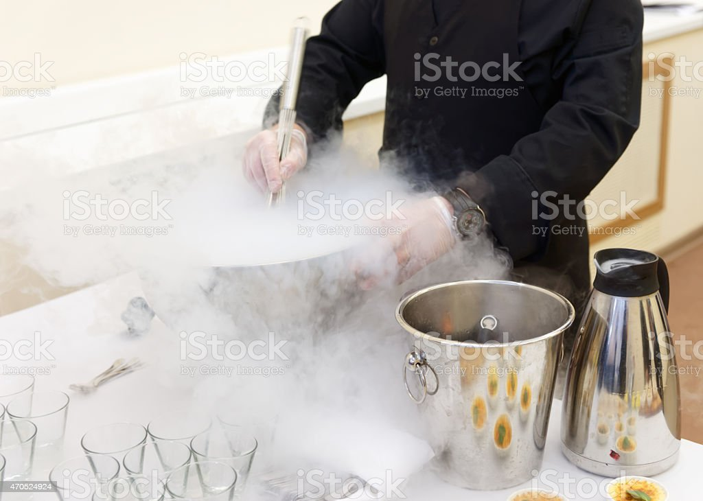 Chef is cooking ice cream with liquid nitrogen stock photo