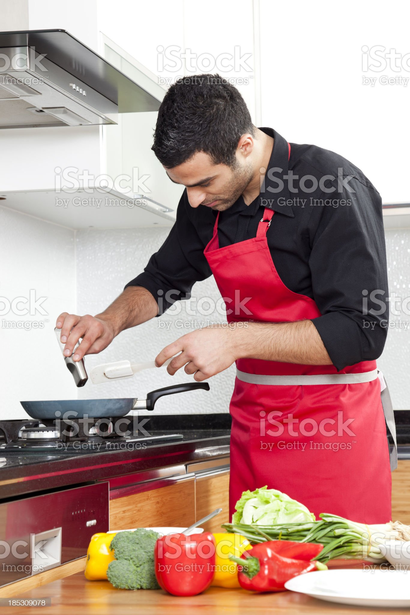 chef is cooking meat adds salt royalty-free stock photo