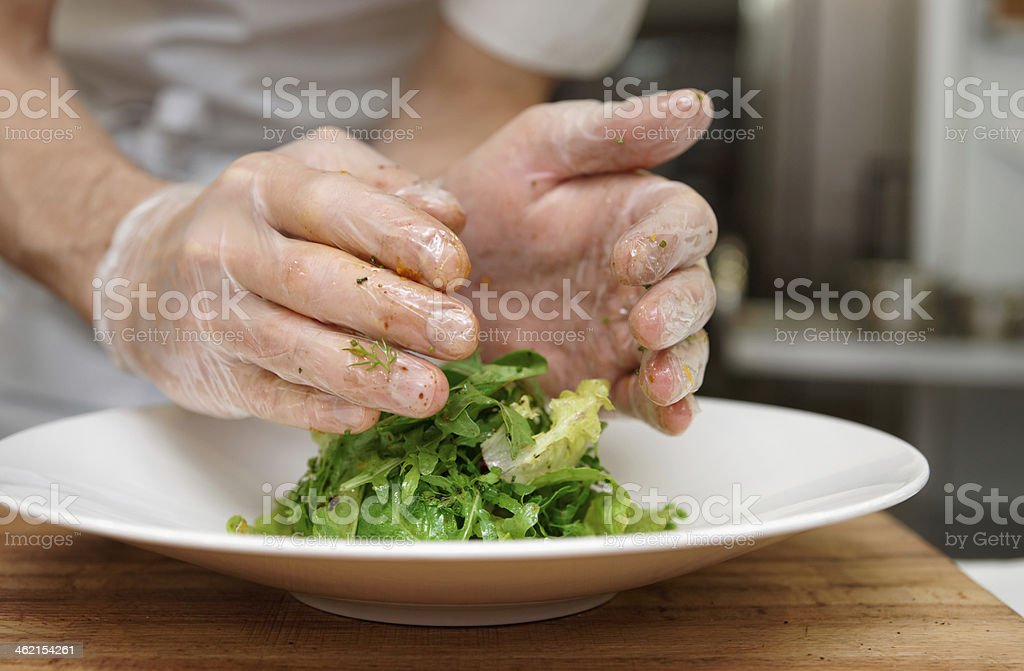 Chef is decorating an appetizer royalty-free stock photo