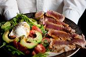 Chef is holding ahi tuna salad