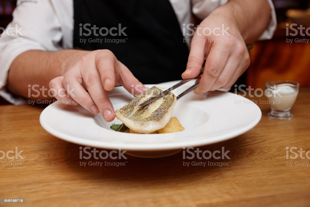 Chef is making appetizer with fish fillet stock photo