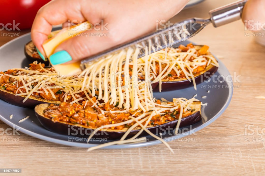 Chef is rubbing cheese stock photo