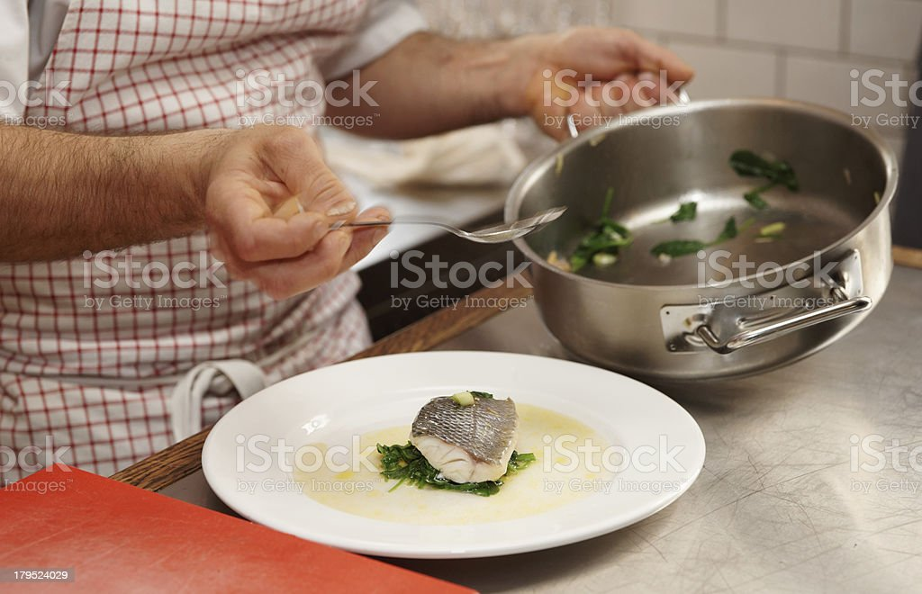 Chef is serving steamed seabass royalty-free stock photo