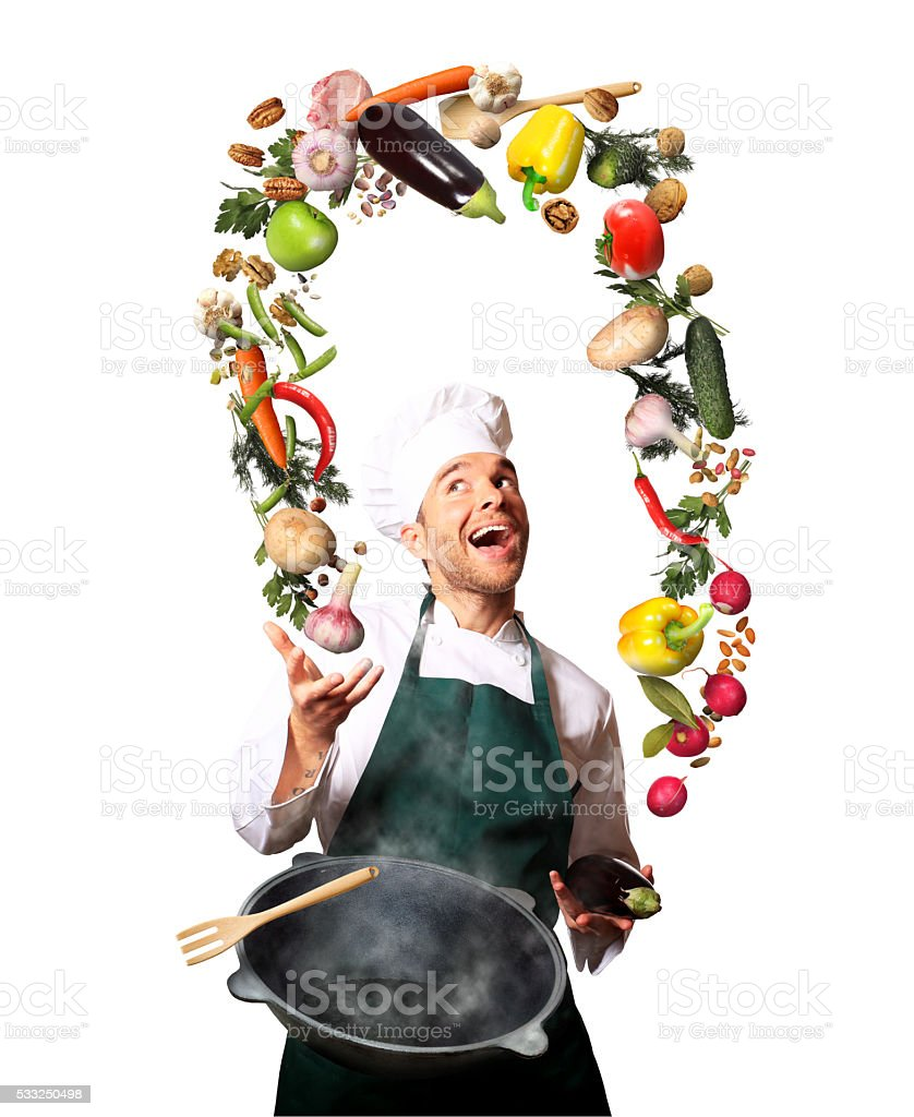 Chef juggling with vegetables stock photo