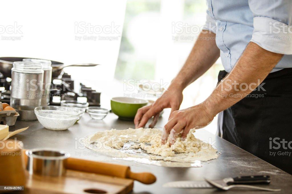 Chef kneading pasta dough stock photo