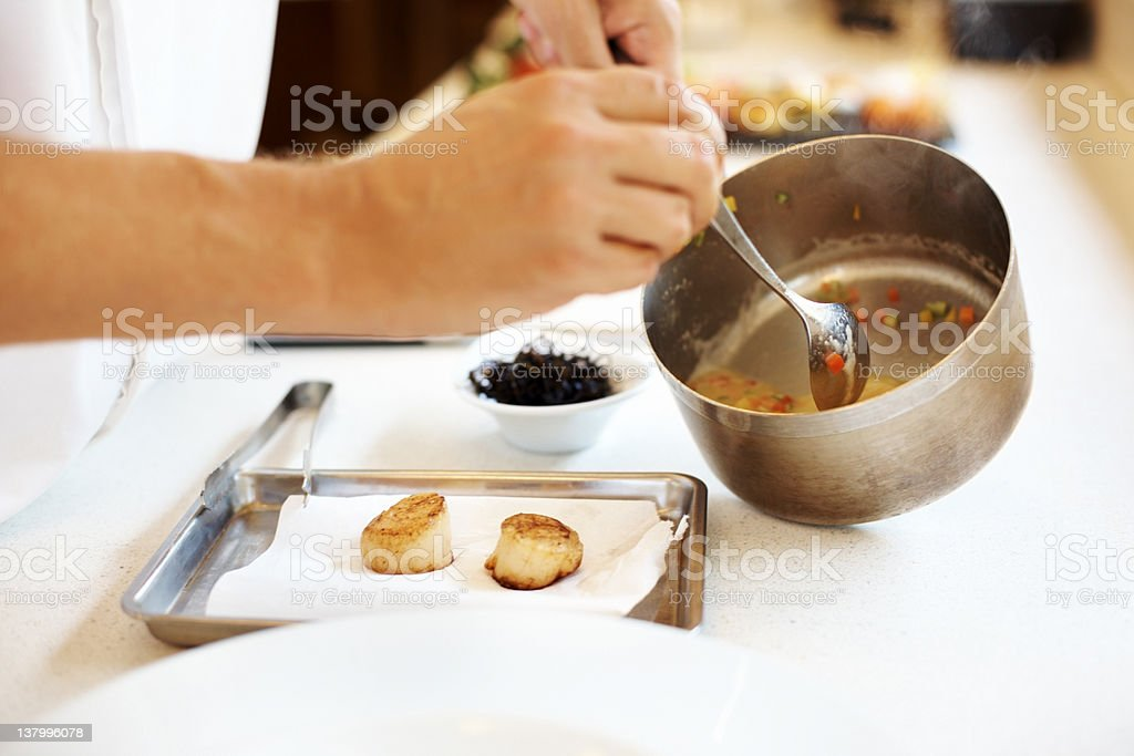 Chef making a dessert in kitchen royalty-free stock photo
