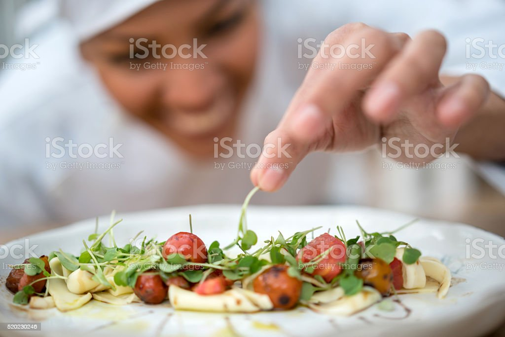 Chef making a salad at a restaurant stock photo