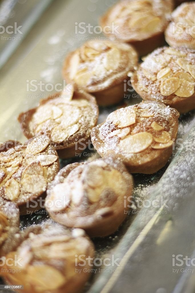 chef making bakewell tarts in kitchen stock photo
