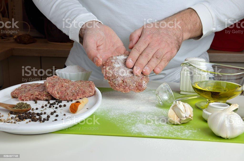 Chef Making Burgers stock photo