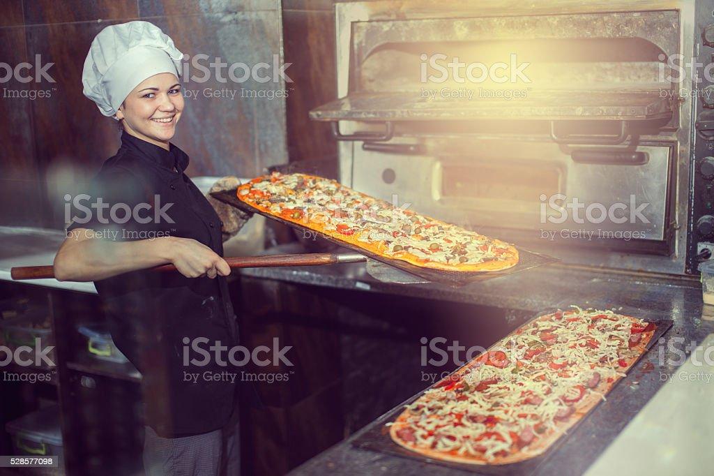 chef making pizza. stock photo