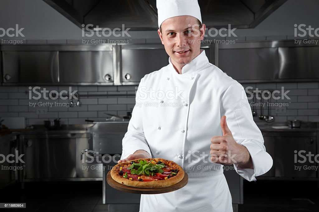 Chef offering the pizza stock photo