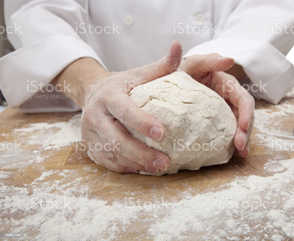 Chef or Baker's Hands kneading bread dough stock photo