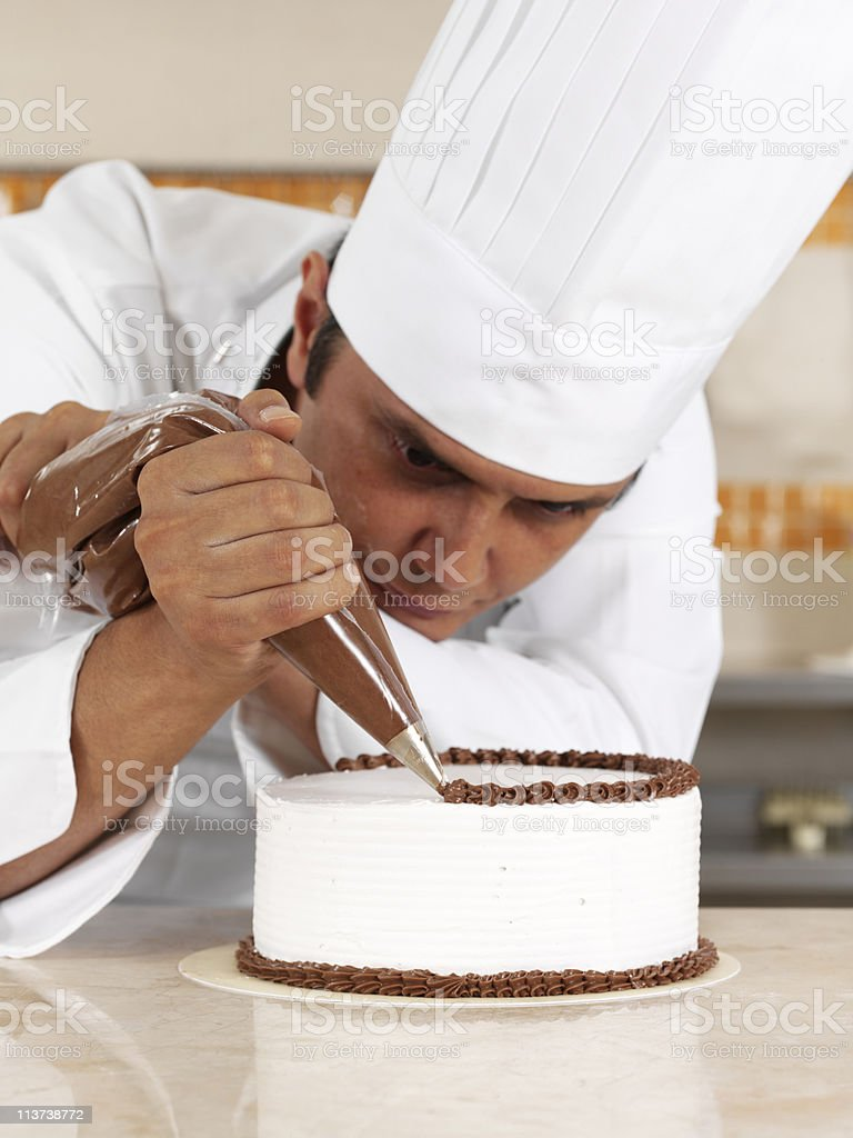 Chef Piping Cream royalty-free stock photo