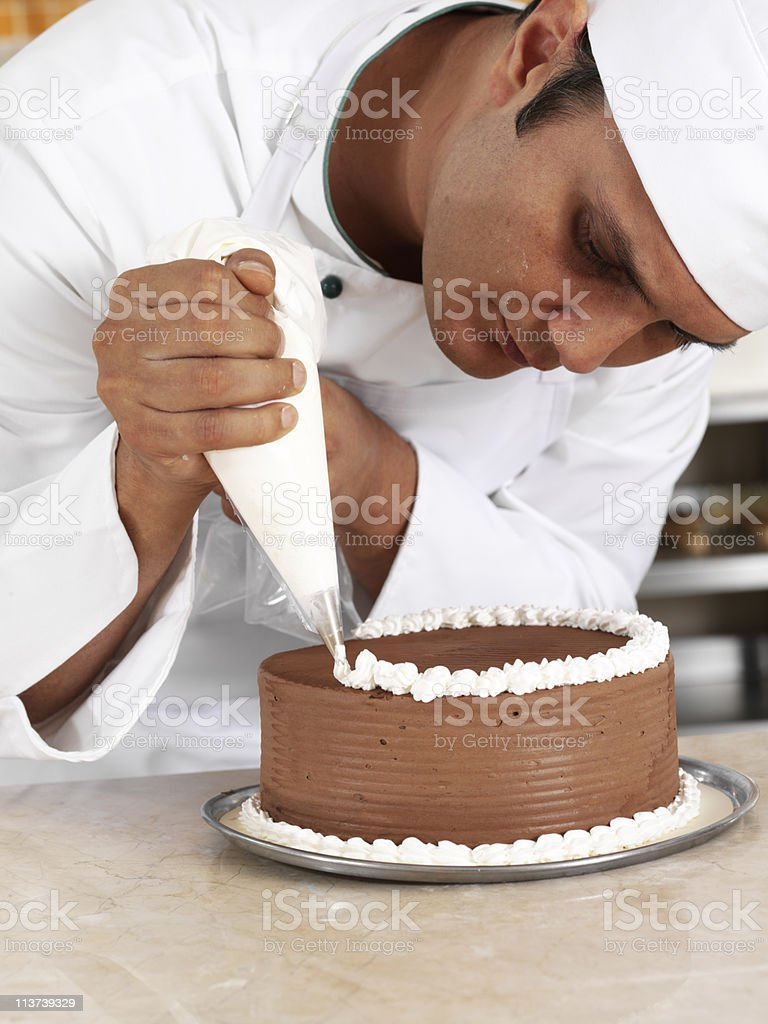 Chef piping cream stock photo