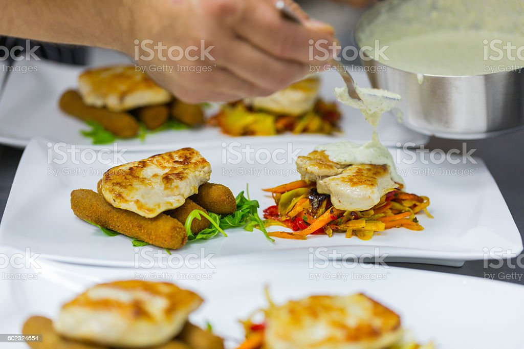 Chef plating white meat stock photo