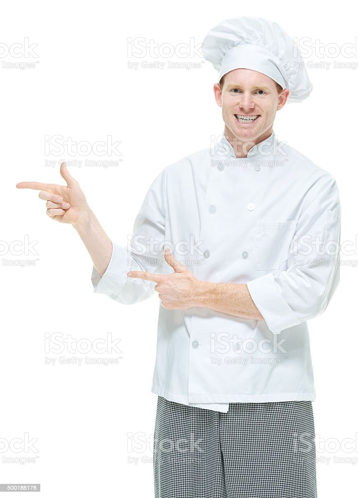 Chef pointing at something stock photo