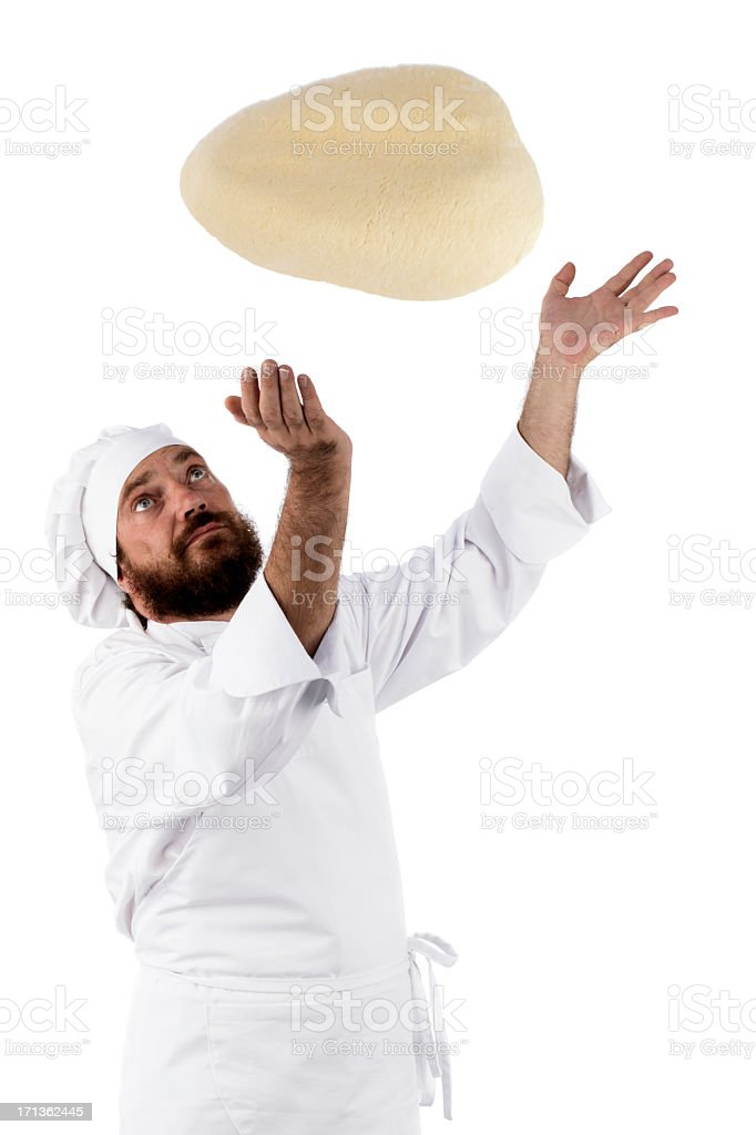 Chef preparing a pizza and flipping the dough in the air  stock photo