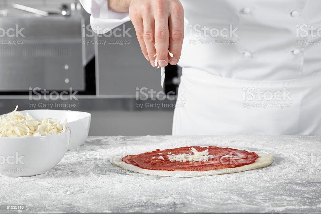 Chef preparing a pizza. stock photo