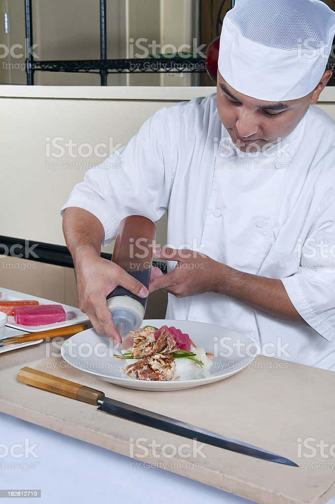 Chef Preparing an Artistic Raw Fish Plate royalty-free stock photo