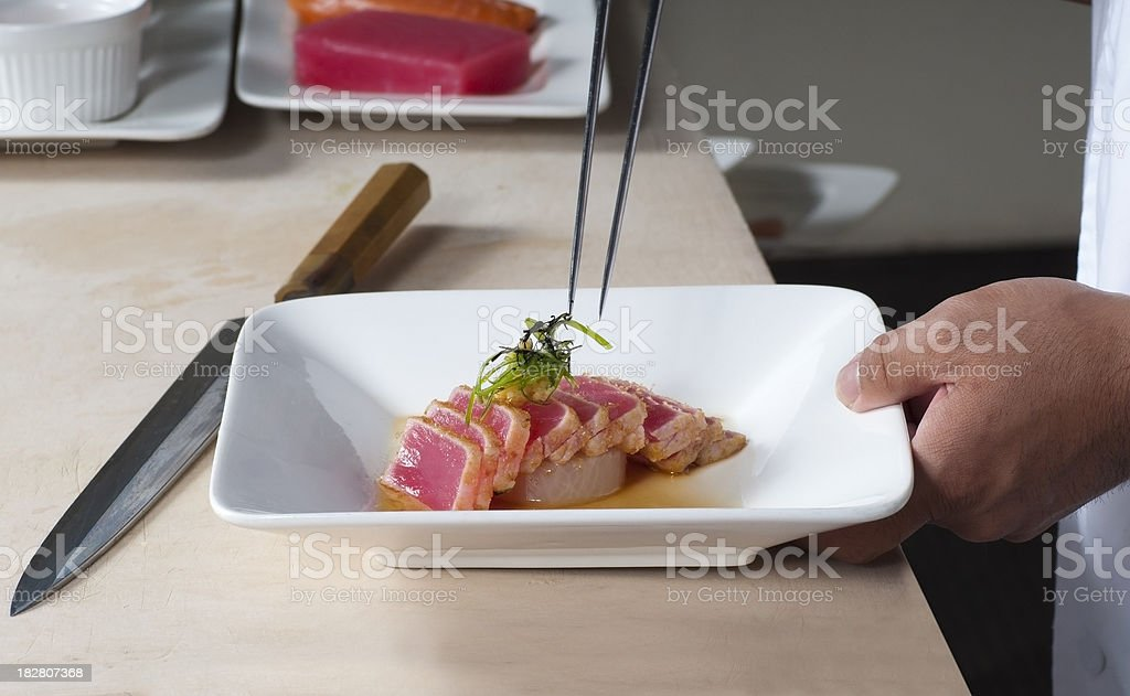Chef Preparing an Artistic Sashimi Plate royalty-free stock photo