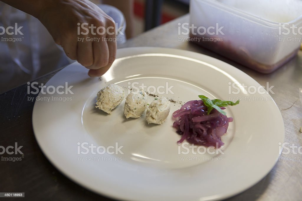 Chef preparing an elegant dish with baccalà Vicenza style stock photo