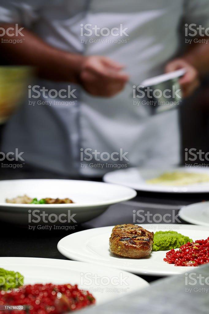 Chef preparing dishes stock photo