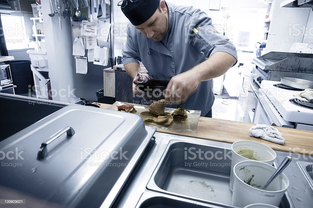 Chef preparing food in a restaurant royalty-free stock photo