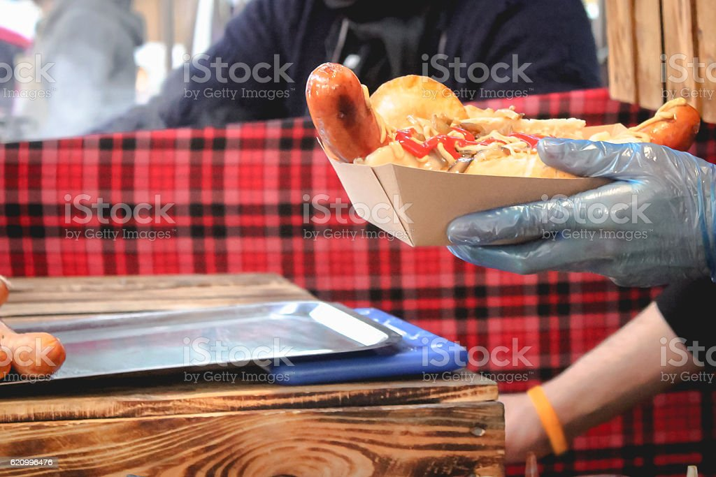 Chef preparing hot dog for take away stock photo
