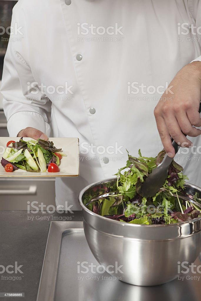Chef Preparing Leaf Vegetables In Commercial Kitchen royalty-free stock photo