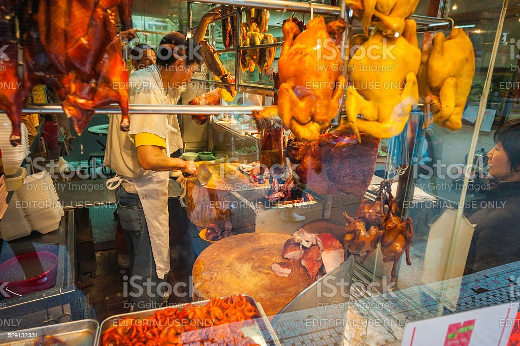Chef preparing meat and poultry street cafe Hong Kong China stock photo