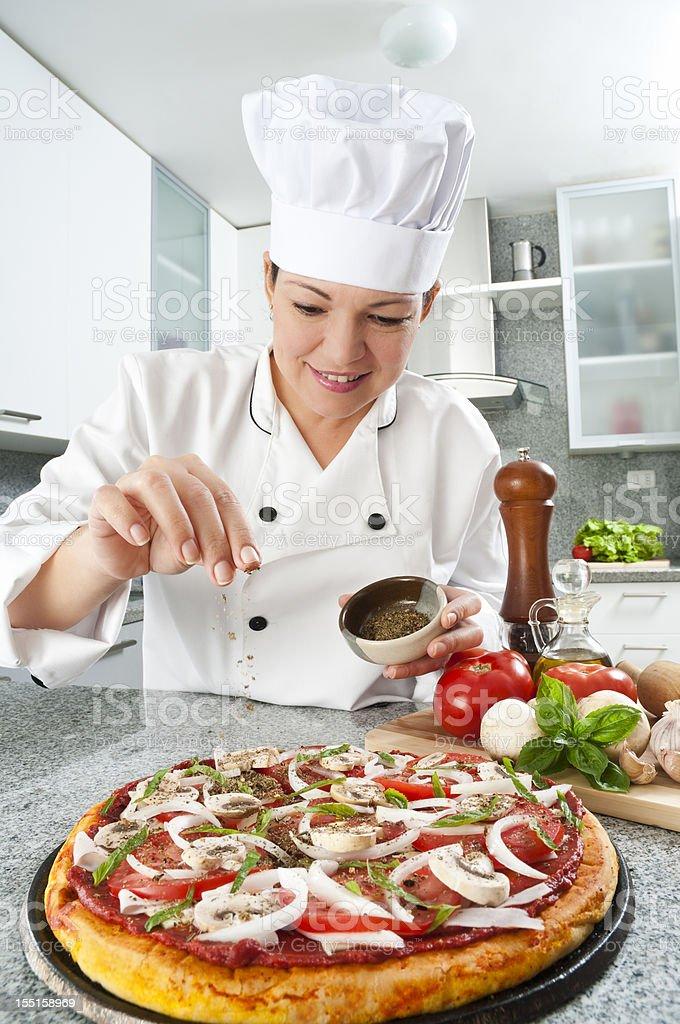 Chef Preparing Pizza royalty-free stock photo