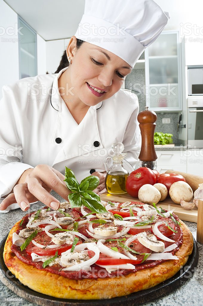 Chef Preparing Pizza royalty-free stock photo