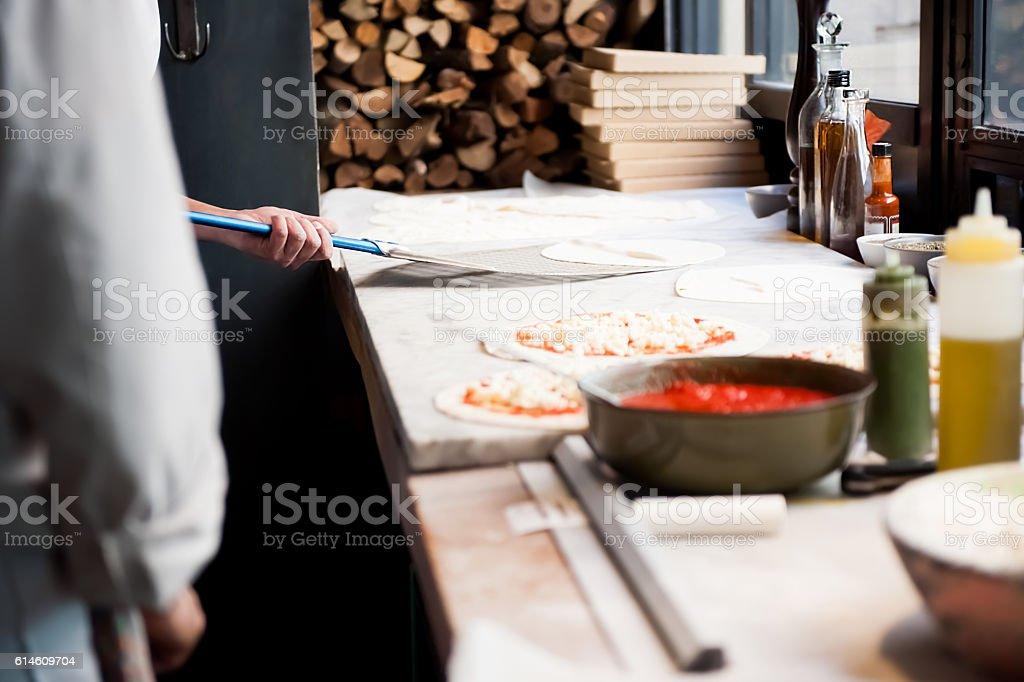 Chef preparing pizza stock photo
