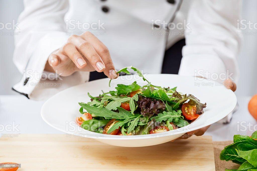 chef preparing salad stock photo