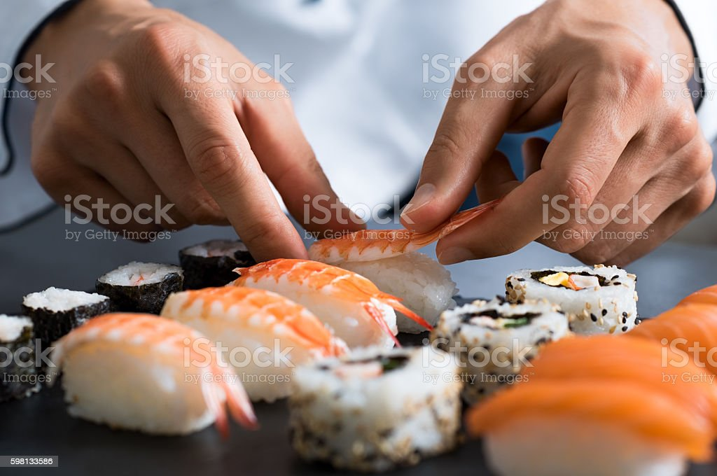 Chef preparing sushi stock photo