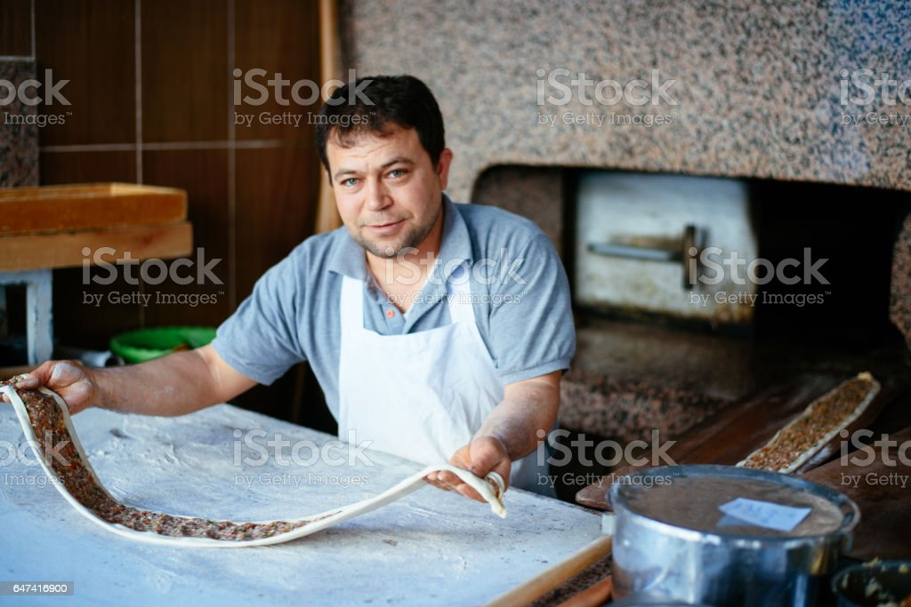 Chef preparing the Turkish pide stock photo
