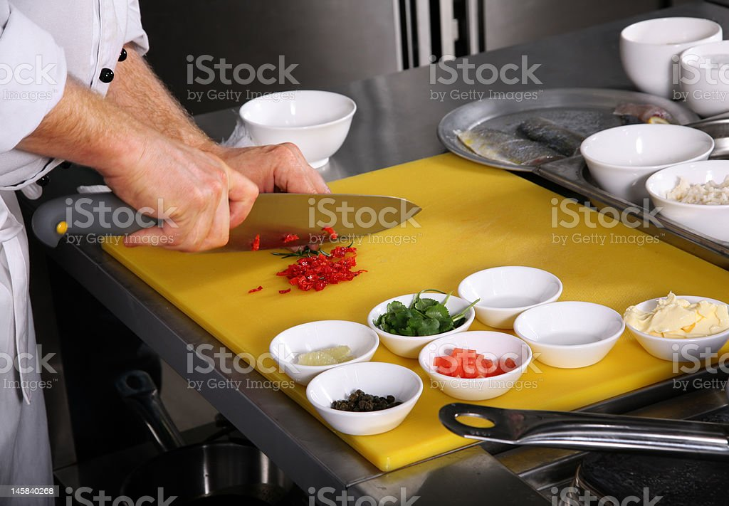 Chef preparing vegetable royalty-free stock photo