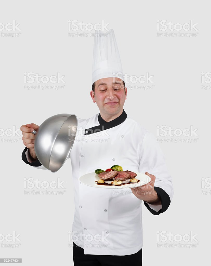 Chef presenting steak dish stock photo