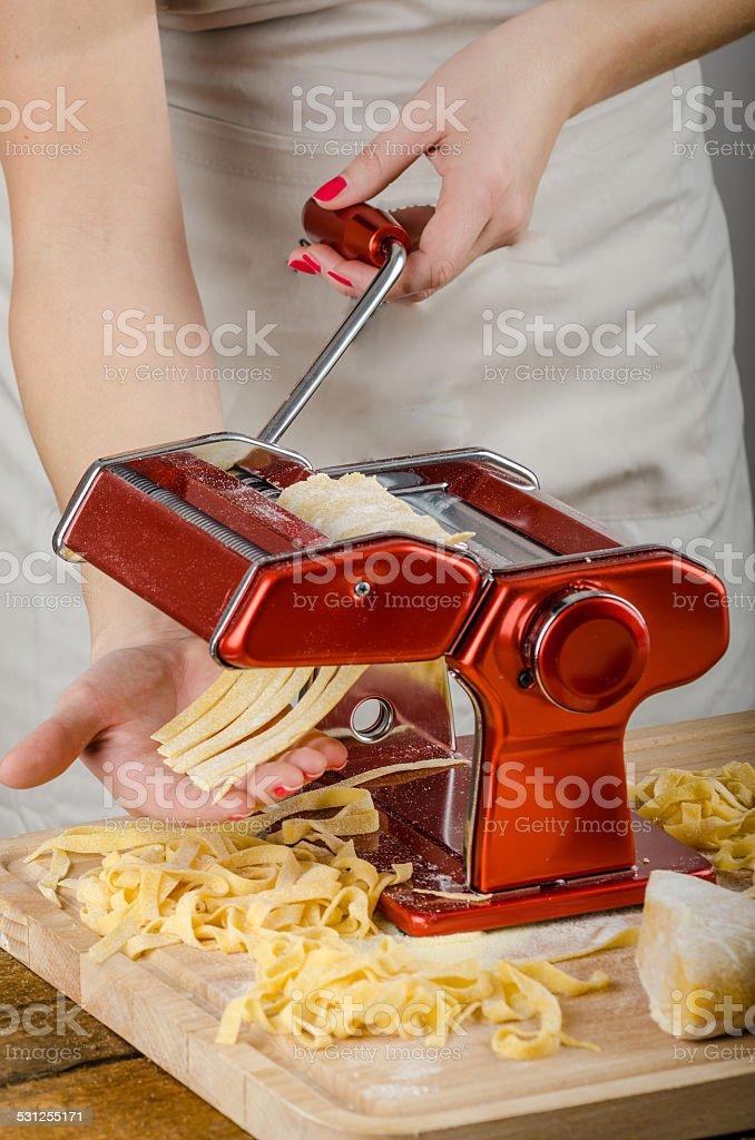 Chef production pasta - Italian pasta grinder stock photo