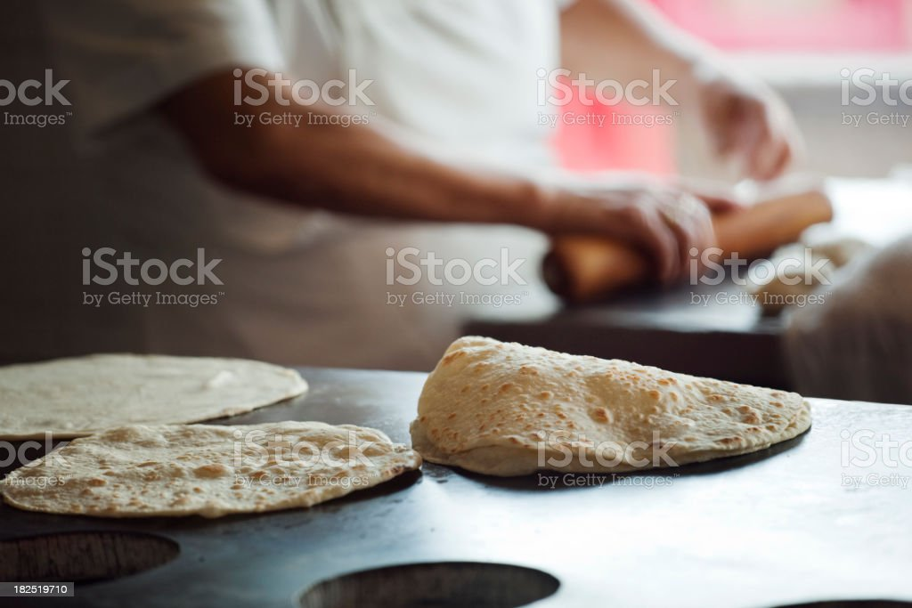 Chef Rolling, Frying Flour Tortillas in Mexican Restaurant Commercial Kitchen stock photo