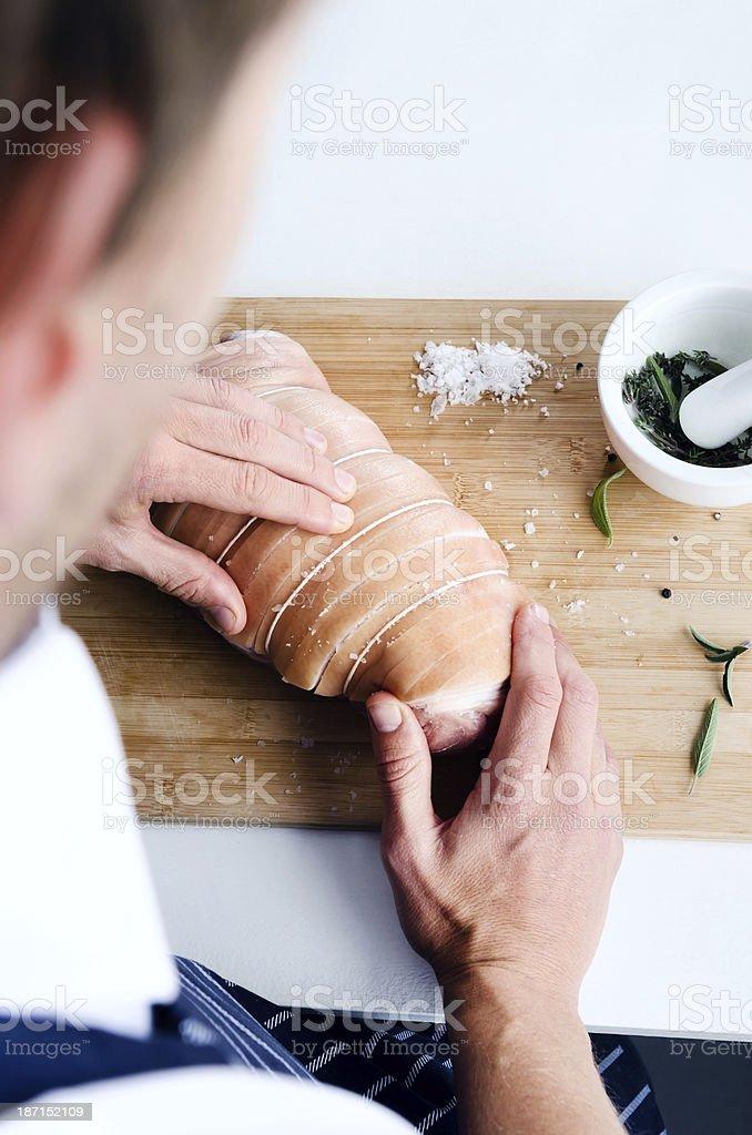 Chef seasoning raw meat royalty-free stock photo