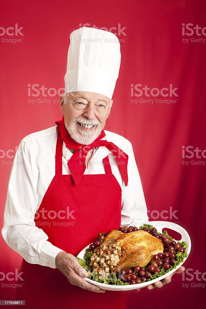 Chef Serves Holiday Dinner royalty-free stock photo