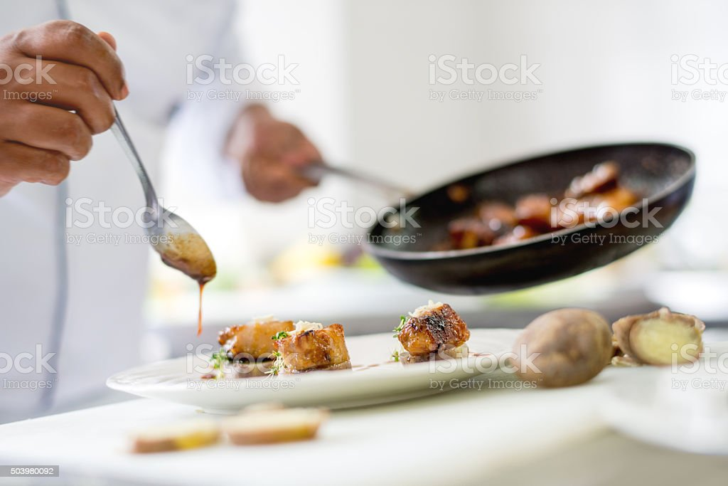 Chef serving a plate stock photo