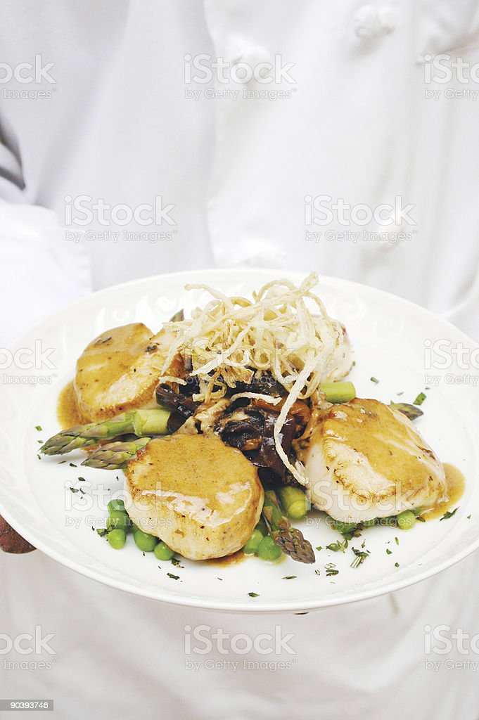Chef serving giant scallops royalty-free stock photo