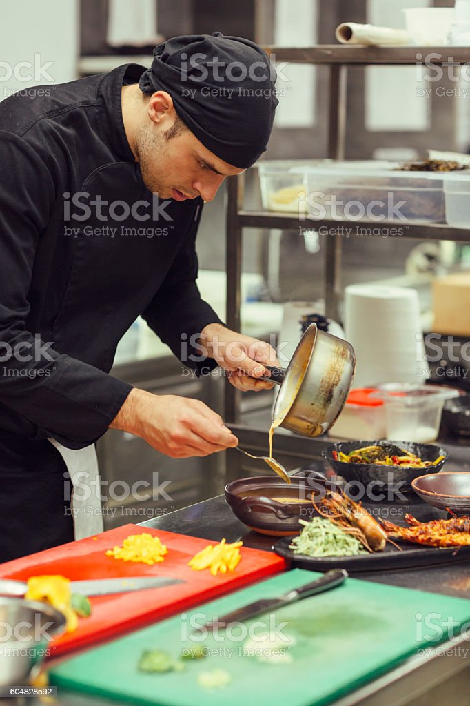 Chef Serving Prawn Red Curry stock photo