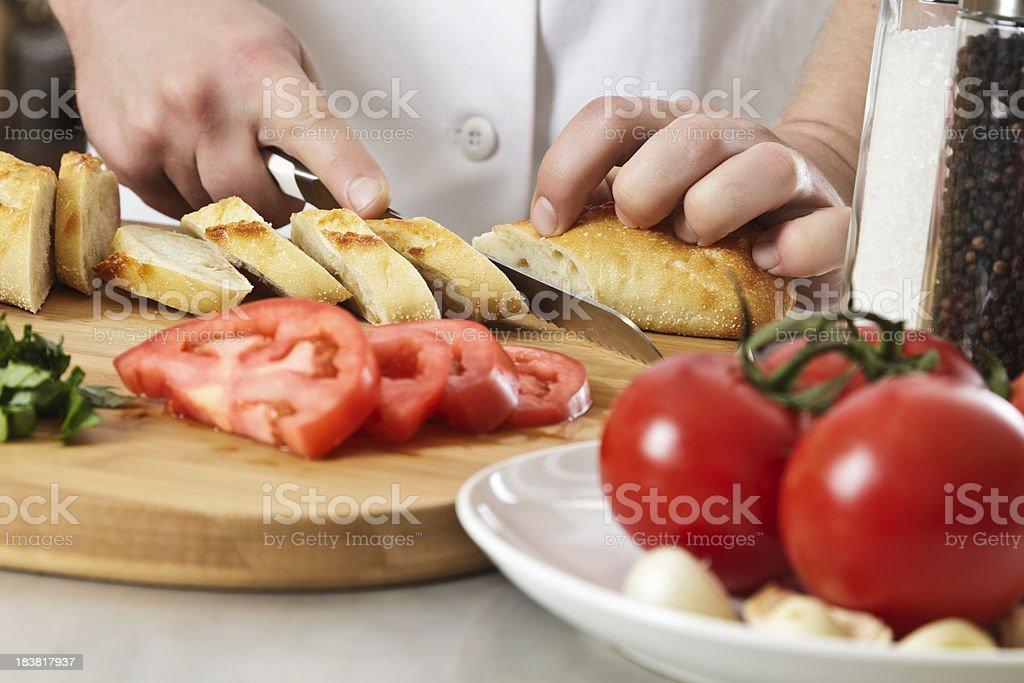 Chef Slicing Bread stock photo